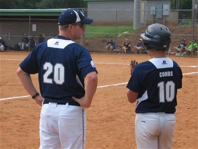 Coach Next to Baseball Player